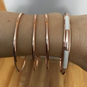 Coach 4 piece bangle in Rose gold